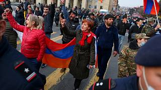 Opposition demonstrators with Armenian national flags rally to pressure Armenian Prime Minister Nikol Pashinyan to resign in Yerevan, Armenia, Wednesday, March 10, 2021.
