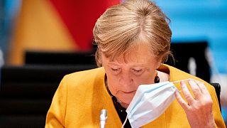 Angela Merkel sah sich angesichts ihrer Kehrtwende zu einer Entschuldigung vor dem Bundestag gezwungen
