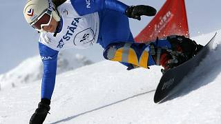 France's Julie Pomagalski speeds down the Parallel Giant Slalom at the FIS Snowboard World Championship in Arosa, Switzerland on Jan. 16, 2007.