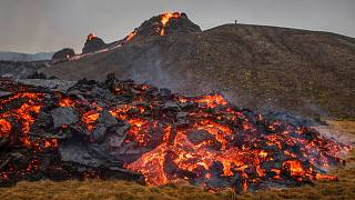 Lava flows from an eruption of a volcano on the Reykjanes Peninsula in southwestern Iceland on Saturday, March 20, 2021