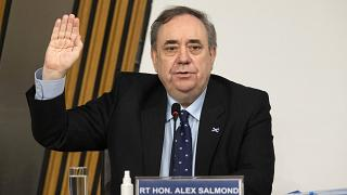 Former Scottish leader Alex Salmond is sworn in before giving evidence to a committee of the Scottish parliament at Holyrood in Edinburgh, Friday Feb. 26, 2021.