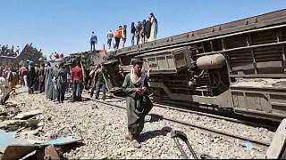 Egypt buries first victims of rail disaster as train traffic resumes