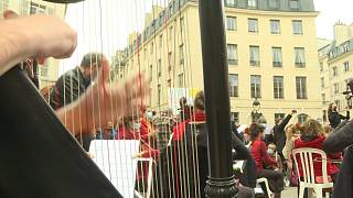 Paris musicians put on concert in front of occupied Odéon Theatre