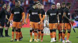 Netherlands' players enters on the field with shirts reading 'Football Supports Change' prior to the start of the World Cup 2022 qualifier vs Latvia on March 27, 2021.