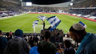 Israeli fans cheer before the World Cup 2022 group F qualifying soccer match between Israel and Denmark in Tel Aviv