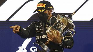 World champion Lewis Hamilton holds off Verstappen to win a tense season-opening Bahrain Grand Prix