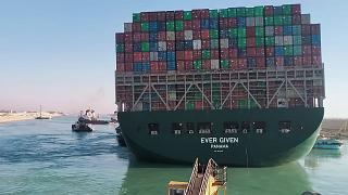 Stranded Suez canal container ship 'Ever Given' partially freed