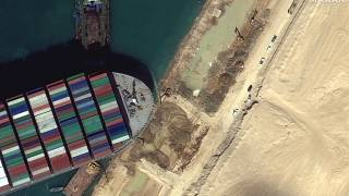 This satellite image from Maxar Technologies shows the cargo ship MV Ever Given stuck in the Suez Canal near Suez, Egypt, Saturday, March 27, 2021.
