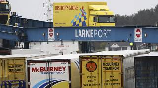 vehicles disembark from a ferry arriving from Scotland at the port of Larne, Northern Ireland Feb. 2, 2021.