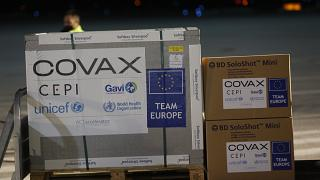 Airport personal unload the first batch of AstraZeneca vaccines sent from the Covax facility.