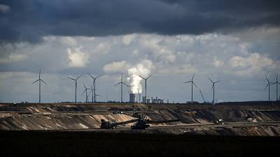 Wind turbines are seen near the open-cast mining and the coal-fired power station Neurath of German energy giant RWE in Garzweiler, western Germany.