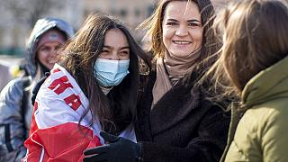 In this Saturday, March 20, 2021 file photo, Belarus opposition leader Sviatlana Tsikhanouskaya, right, poses for photos with protesters.