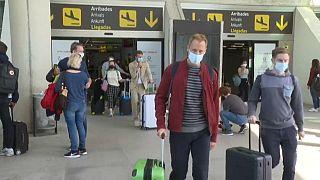 Tourists arrive to Palma de Mallorca airport