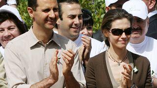 الرئيس السوري بشار الأسد وزوجته أسماء خلال افتتاح مهرجان الياسمين وسط دمشق،2007.