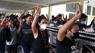 Three finger salutes at Myanmar funerals