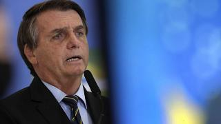 Brazil's President Jair Bolsonaro speaks at a ceremony announcing economic measures to support philanthropic hospitals and help them treat COVID-19 patients.