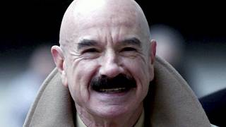 This Jan. 16, 2001, file photo shows G. Gordon Liddy, a Watergate conspirator, arriving at Baltimore's federal courthouse.