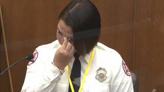 In this image from video, Minneapolis Firefighter Genevieve Hansen, wipes her eyes as she testifies on March 30, 2021.