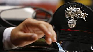 FILE! - The hat of a Carabinieri paramilitary police officer on a table in a courtroom in Rome, July 16, 2020.
