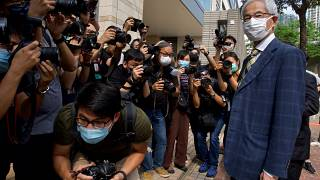 Pro-democracy lawmaker Martin Lee, right, arrives at a court in Hong Kong Thursday, April 1, 2021.