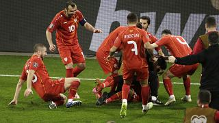North Macedonia's Eljif Elmas, not seen in the frame, celebrates with his teammates after scoring his side's second goal during the group J qualifying game agaist Germany