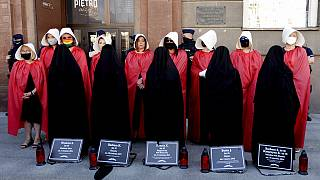 "FILE photo from July 24, 2020, women dressed to evoke the feminist dystopian story ""The Handmaid's Tale"""
