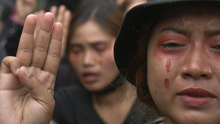 Crying and song as Myanmar anti-coup protesters don red 'blood' tears