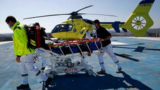 Medical workers bring an emergency arrival on the rooftop of the Amiens Picardie hospital, March 30, 2021 in Amiens, France.