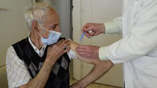 A doctor vaccinates a patient with the second dose of COVID-19 vaccine produced by Chinese Sinopharm in Taplanszentkereszt, Hungary, April 1, 2021