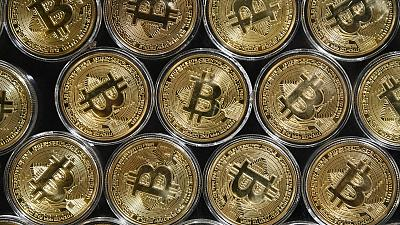 """A physical imitation of a Bitcoin at a crypto currency """"Bitcoin Change"""" shop, near Grand Bazaar, in Istanbul."""