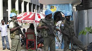 FILE: UN forces stand guard on a street in Abidjan, Ivory Coast, Dec. 22, 2010.