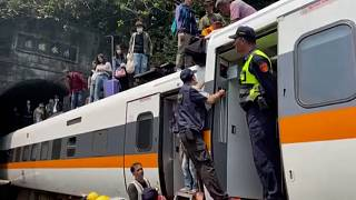 Survivors led away from Taiwan train crash as dead toll rises