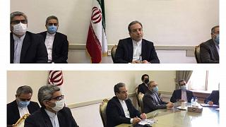 This combined photo from Iran's Foreign Ministry shows Iranian diplomats on a virtual talk on nuclear deal with representatives of world powers, in Tehran, April 2, 2021