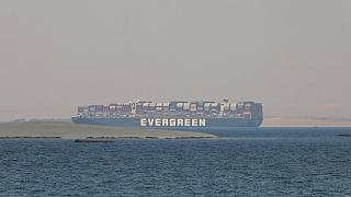 FILE: Ever Given, a Panama-flagged cargo ship, is seen in Egypt's Great Bitter Lake Tuesday, March 30, 2021.