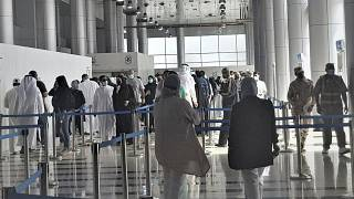 People stand in line at Kuwait Vaccination Centre to get the vaccine in Kuwait.