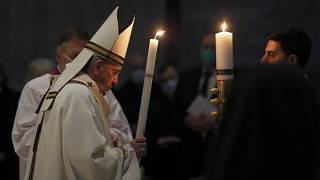 Pope Francis celebrates the Easter Vigil in a nearly empty St. Peter's Basilica as coronavirus pandemic restrictions stay in place for a second year running, at the Vatican.