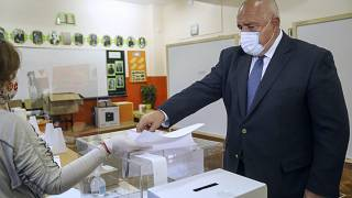 Bulgarian Prime Minister Boyko Borissov casts his ballot during parliamentary elections in the town of Bankya, Bulgaria, Sunday, April 4, 2021.