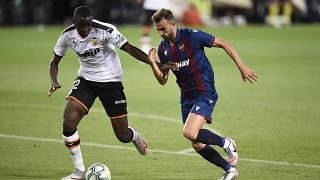 FILE PHOTO: Valencia's French defender Mouctar Diakhaby (L) vies with Levante's Spanish forward Borja Mayoral during A Spanish League football match, June 12, 2020.