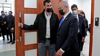 Israeli Prime Minister Benjamin Netanyahu leaves the courtroom at district court in Jerusalem, during his corruption trial.