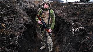 A Ukrainian serviceman, who asked to be identified only by his call sign, Kram, stands at his post in the town of Krasnohorlivka, eastern Ukraine, Friday, March 5