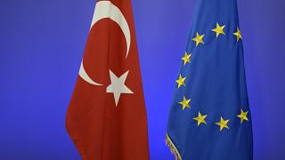 An archive image of  the Turkish national flag and the EU flag