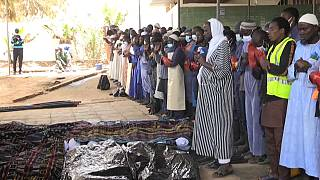 Senegalese Muslim volunteers bury unidentified dead