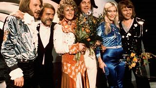 """In this April 6, 1974 file photo, members of Swedish group ABBA and close associates celebrate the victory of their song """"Waterloo"""" in the Eurovision Song Contest in Brighton"""