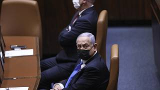 Israeli Prime Minister Benjamin Netanyahu, front, attends the swearing-in ceremony for Israel's 24th government at the Knesset in Jerusalem, Tuesday, April 6, 2021.