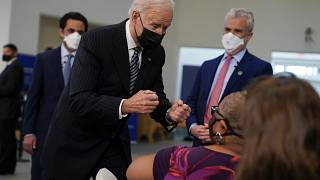 President Joe Biden talks to a person receiving a COVID-19 vaccination shot as he visits a vaccination site at Virginia Theological Seminary, Tuesday, April 6, 2021.