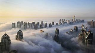 In Oct. 5, 2015 file photo, a thick blanket of early morning fog partially shrouds the skyscrapers of the Marina and Jumeirah Lake Towers districts of Dubai.