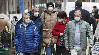 People wear face masks at a shopping street in Gelsenkirchen, Germany, Tuesday, April 6, 2021.