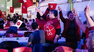 Members of the IA (Inuit Ataqatigiit) party celebrate following Tuesday's exit poll results in Nuuk.