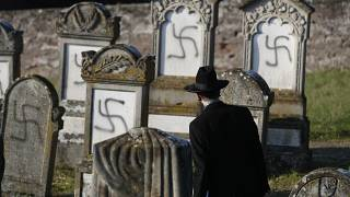 In this Dec. 4, 2019 file photo, Strasbourg chief Rabbi Harold Abraham Weill looks at vandalized tombs in the Jewish cemetery of Westhoffen, west of the city of Strasbourg.