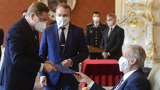 Czech president Milos Zeman, right, appoints Petr Arenberger, left, director of the Prague-Vinohrady Teaching Hospital, as the new Czech health minister
